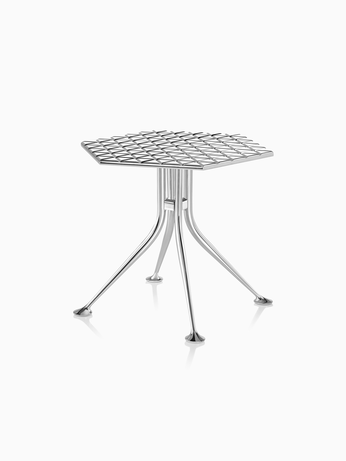A polished aluminum Girard Hexagonal Table with dozens of triangles inscribed into the top.