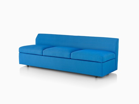 Angled view of an armless Bevel Sofa with blue upholstery.
