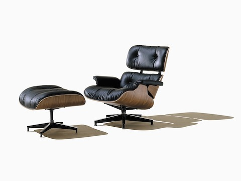 Angled view of a black leather Eames Lounge Chair and Ottoman.