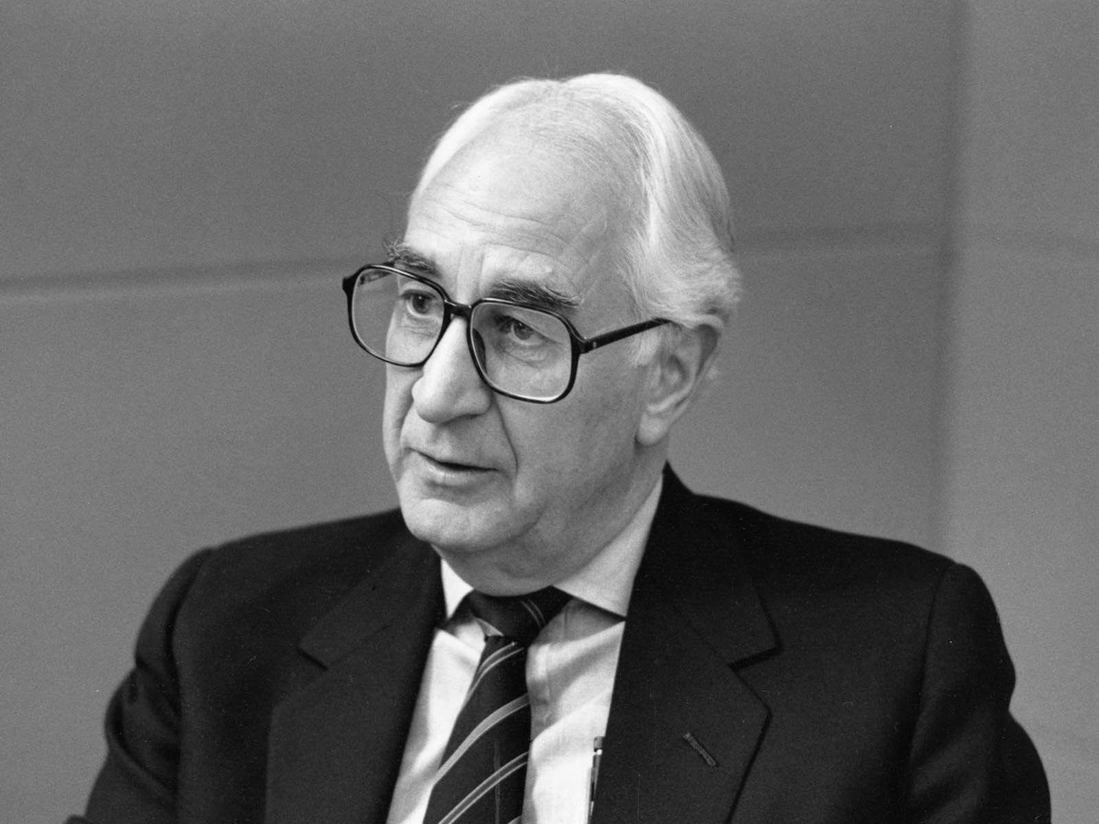 A black-and-white photo of former Herman Miller CEO Max De Pree.