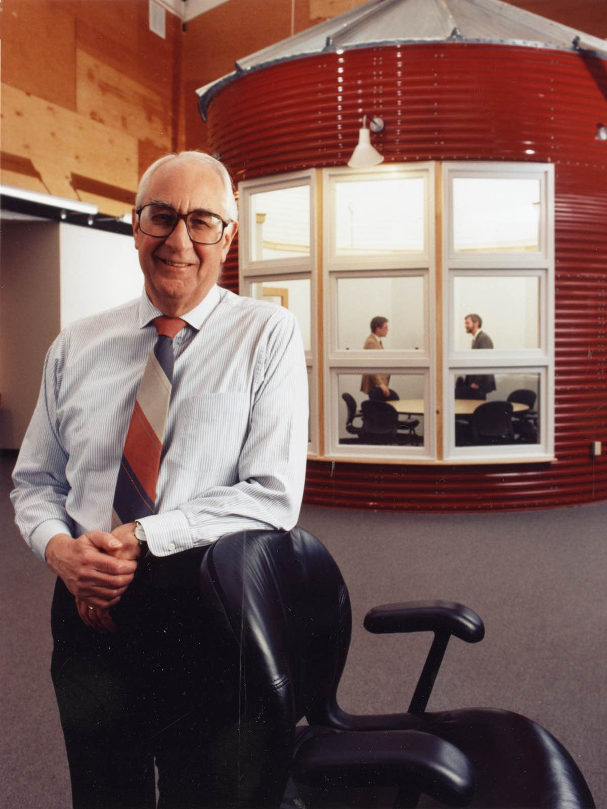 Former Herman Miller CEO Max De Pree leans on a chair in Herman Miller's Design Yard facility in Holland, Michigan.