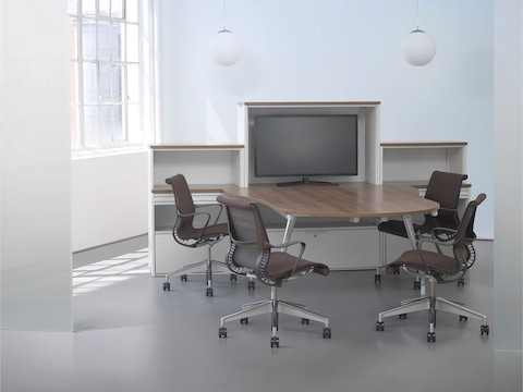 AbakEnvironments storage elements anchor a video conferencing setup that includes a peninsula surface and Setu office chairs.