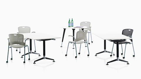 A variety of AbakEnvironments surfaces, surrounded by Caper Stacking Chairs with casters.