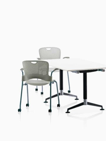 A work setting featuring black Aeron office chairs and oval, rectangular, and linear surfaces from AbakEnvironments. Select to go to the AbakEnvironments product page.