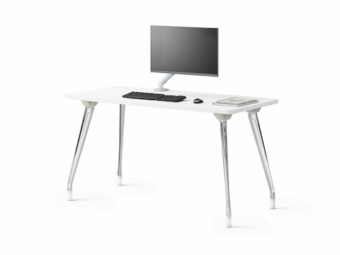 A single AbakEnvironments Desk with white top, attached monitor screen, keyboard and dressings.