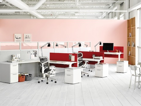 Mirra 2 ergonomic office chairs in an open office with Action Office workstations and Renew sit-to-stand desks.
