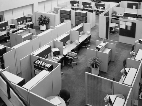 Archival photograph showing an overhead view of an office made of Action Office System with computer terminals, typewriters, and storage systems.