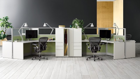 Black Aeron ergonomic desk chairs at Action Office workstations in an open office.