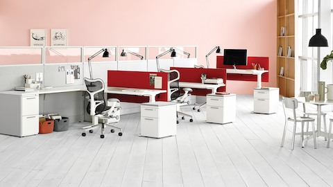 Action Office workstations with glass dividing walls with black Mirra 2 ergonomic desk chairs.