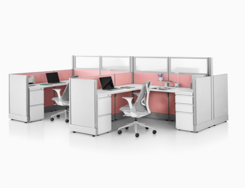 Gray Sayl Chairs at Action Office workstations with pink fabric panels and glass dividing walls.