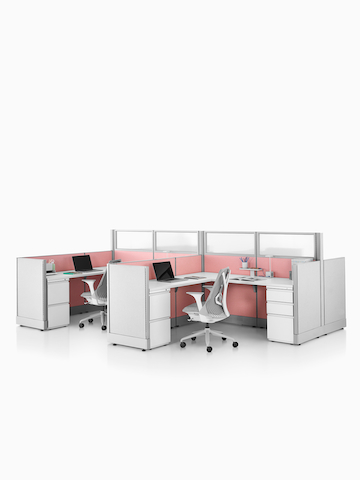 Two Action Office System open workstations with gray Sayl office chairs.