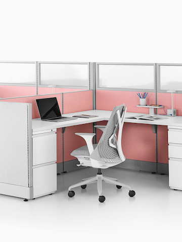 Two Action Office System open workstations with gray Sayl office chairs. Select to go to the Action Office System product page.