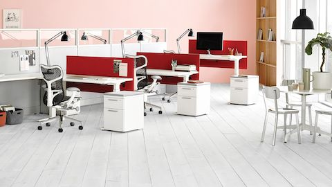 Mirra 2 ergonomic desk chairs in an open office at Action Office Workstations with red fabric dividing screens and task lighting.