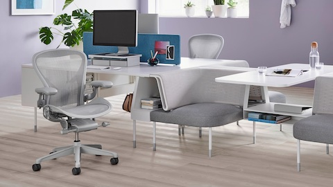 Two light gray Aeron office chairs in a Public Office Landscape setting.