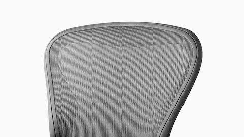 Close-up of the mesh back on a light gray Aeron office chair.