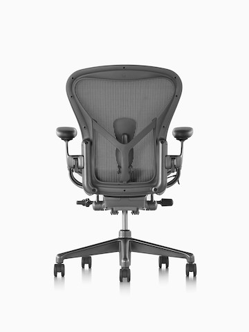 Black Aeron office chair with aluminum base, viewed from the back.