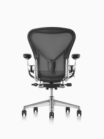Black Aeron office chair with black base, viewed from the back.