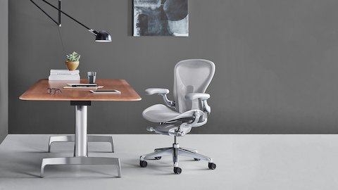 Small office with a light gray Aeron office chair and an AGL Table with a veneer top.