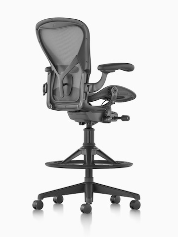 Three-quarter rear view of a black Aeron Stool.