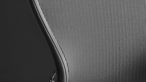Close view of the suspension mesh on the back of a black Aeron Stool.