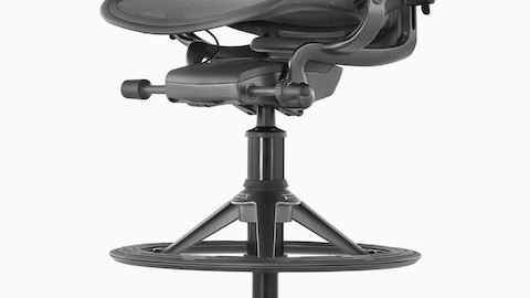 Profile view of the wide, treaded footring on an Aeron Stool.