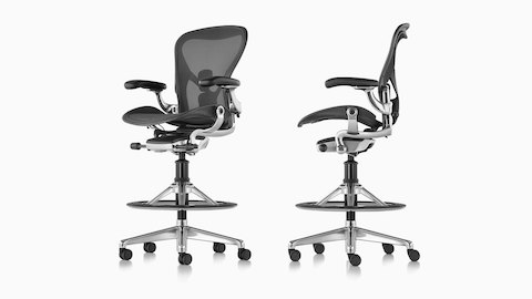 Views from an angle and profile of two black Aeron Stools.