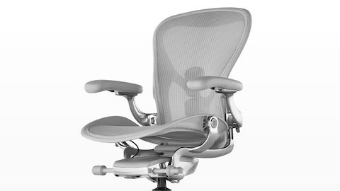 Upper half of a light gray Aeron Stool, viewed from a 45-degree angle.