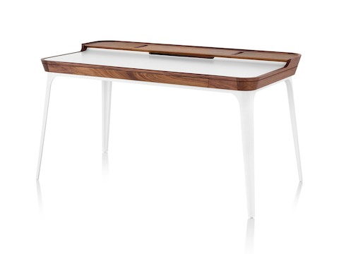 Three quarter profile view of white Herman Miller Airia Desk with dark wood trim and white legs.