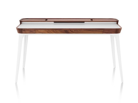 Front view whitesweep of Herman Miller Airia Desk in white with dark wood trim and white legs.