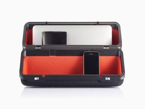 An Anywhere Case with a red lining, positioned vertically and containing a smartphone, eyeglasses, and laptop.
