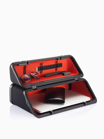 An Anywhere Case containing eyeglasses, writing utensils, and a laptop. Select to go to the Anywhere Case product page.