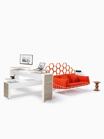 An Arras Spine work area complemented with a red Wireframe Sofa. Select to go to the Arras Spine product page.