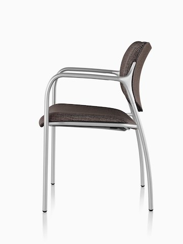 Profile view of a brown Aside Chair with silver arms.