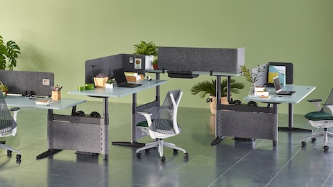 Sayl office chairs complement a zigzag configuration of four height-adjustable Atlas Office Landscape desks with blue tops.