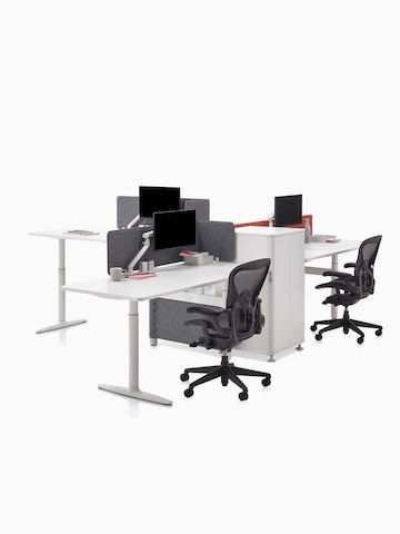 Three height-adjustable workstations designed for collaboration. Select to go to the Atlas Office Landscape product page.