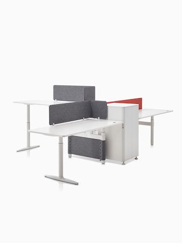 A collaboration cluster of three height-adjustable Atlas Office Landscape desks with gray privacy screens.