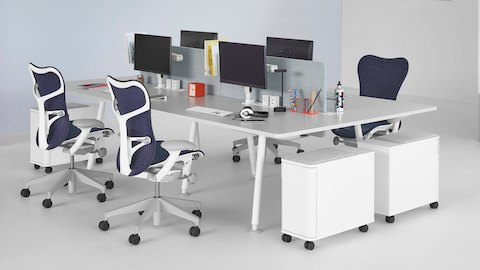 A collaboration area featuring Memo, Atlas Storage, and blue Mirra 2 office chairs.