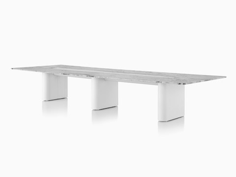 Axon Table with Georgia Grey Marble, viewed from the front/side.