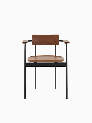 A Betwixt Chair with a walnut backrest, seat, and arms with a black frame.