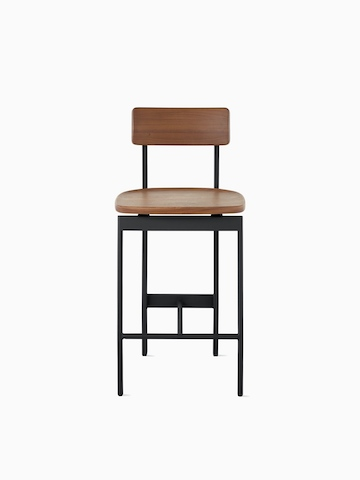 A counter height Betwixt Stool with a walnut seat and back and a black frame.