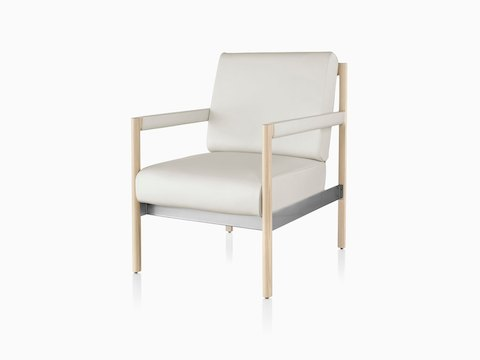 A white Brabo chair with leather upholstery and wood legs in a light finish, viewed from a 45-degree angle.