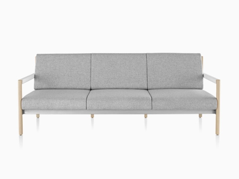 A light gray Brabo sofa with wood legs and white arms, viewed from the front.