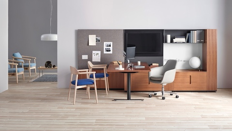 Two Crosshatch side chairs sit opposite a Saiba desk chair in a private office with Geiger casegoods.