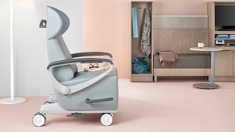 A Nemshoff patient chair sits in a bright, inviting clinical setting.
