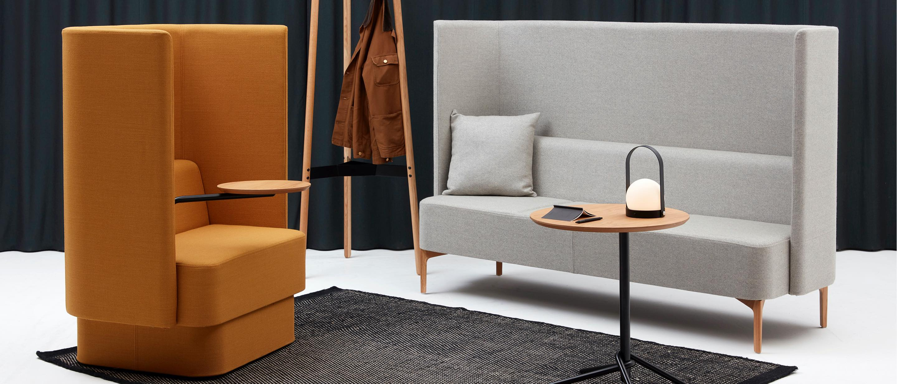 A casual interaction space featuring gray Hush lounge chairs from naughtone.