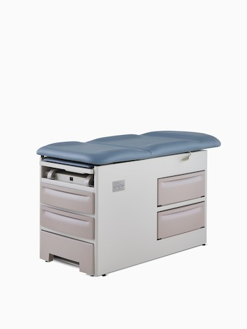Three-quarter, left view of an exam table with a blue upholstered back and seat laying flat with a taupe metal base.