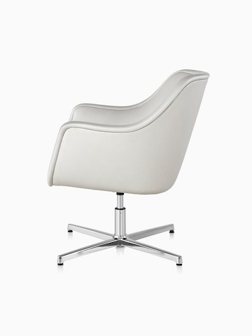 White leather Bumper Chair with a four-star base, viewed from the side.