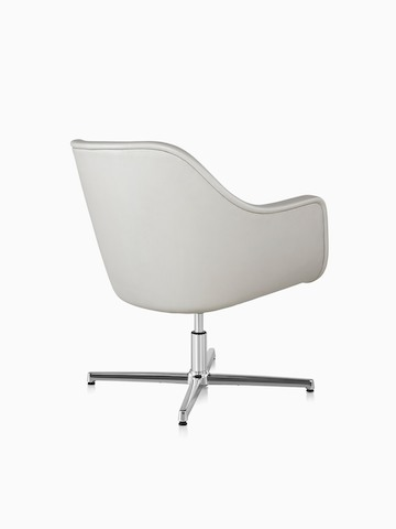 Three-quarter rear view of a white leather Bumper Chair with a four-star base.