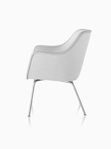 Four-leg Bumper Chair in light gray fabric, viewed from the side.