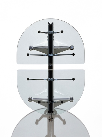 Overhead view of a Burdick table, showing two semi-circle glass tops and the central aluminum beam beneath.